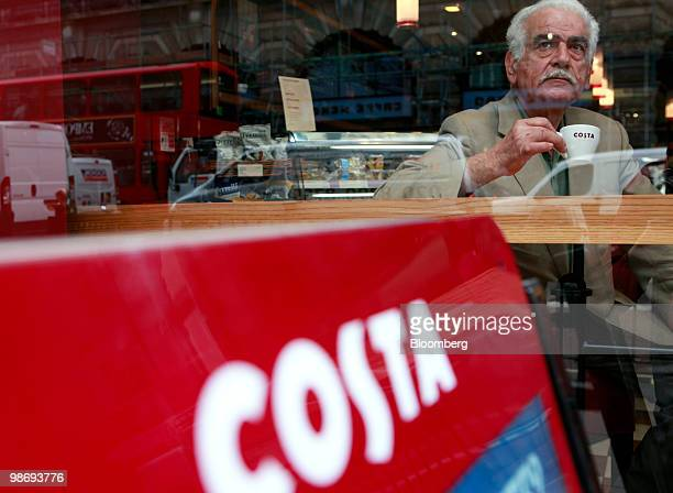 A customer drinks a coffee in a Costa Coffee shop in London UK on Monday April 26 2010 Whitbread Plc which own Costa Coffee announce earnings on...