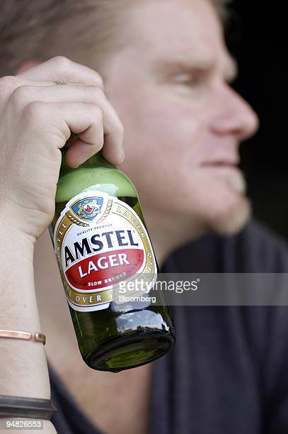 A customer drinks an Amstel Lager beer at a bar in Melville Johannesburg South Africa Sunday May 16 2004 SABMiller Plc the world's fourthlargest...