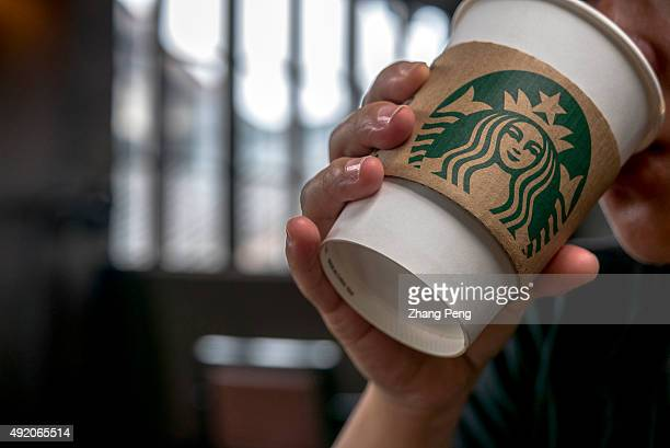 Customer drinks coffee in a Starbucks cafe Starbucks is streamlining the ordering process so customers are able to get that cup of coffee faster than...