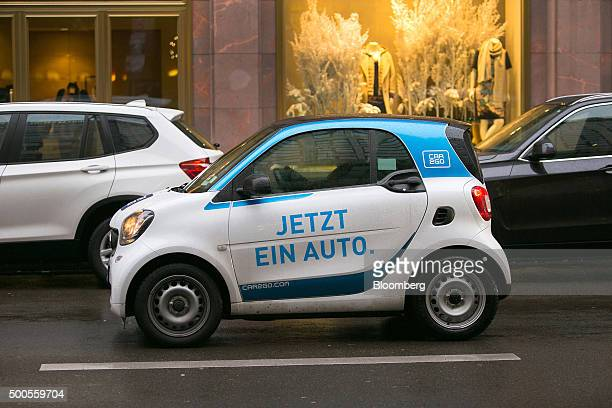 A customer drives a Daimler AG Smart ForTwo Car2Go carsharing automobile in Berlin Germany on Wednesday Dec 9 2015 Daimler will review its management...