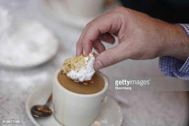 A customer eats a beignet at Cafe Du Monde in the French Quarter of New Orleans Louisiana US on Wednesday Feb 7 2018 New Orleans prepares for its...