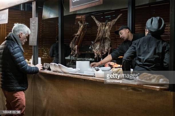 A customer eats as goats roast at a restaurant inside La Exposicion Rural agricultural and livestock show in the Palermo neighborhood of Buenos Aires...