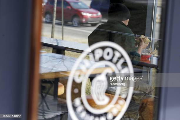 A customer eats food at a Chipotle Mexican Grill Inc restaurant in Louisville Kentucky US on Saturday Feb 2 2019 Chipotle Mexican Grill Inc is...