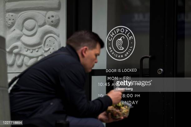 A customer eats outside a Chipotle Mexican Grill Inc restaurant in San Francisco California US on Monday July 20 2020 Chipotle is scheduled to...