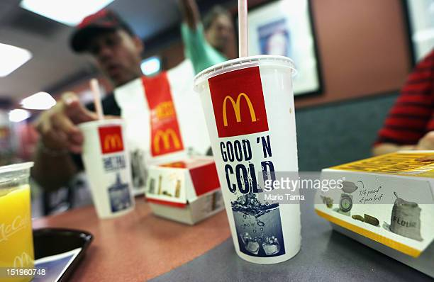 A customer eats with a 21 ounce cups of soda at a Manhattan McDonalds on September 13 2012 in New York City In an effort to combat obesity the New...