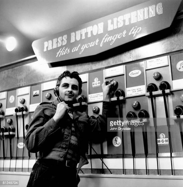 A customer enjoys a record at the press button listening panel in the HMV shop at 363 Oxford Street London 24th November 1955 The huge youth market...