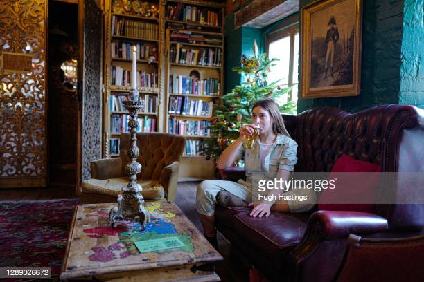 Customer enjoys her drink at the Chintz Emporium on December 2, 2020 in Falmouth, United Kingdom. Last night MPs voted in favour of government...