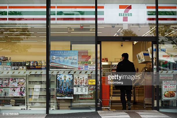 A customer enters a 7Eleven convenience store operated by Seven i Holdings Co in Kawasaki City Kanagawa Prefecture Japan on Tuesday April 5 2016...