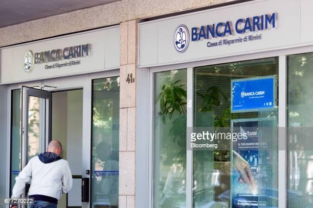 Customer enters a Banca Carim Cassa di Risparmio di Rimini SpA bank branch in Rome, Italy, on Tuesday, May 2, 2017. Credit Agricole SA's Italian...
