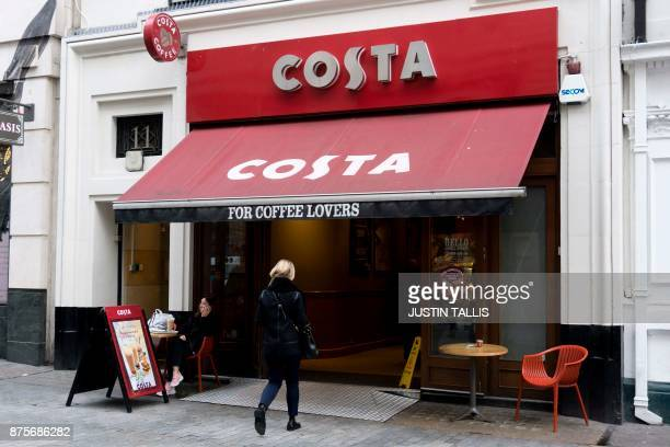 A customer enters a branch of a Costa coffee shop in London on November 15 2017 / AFP PHOTO / Justin TALLIS