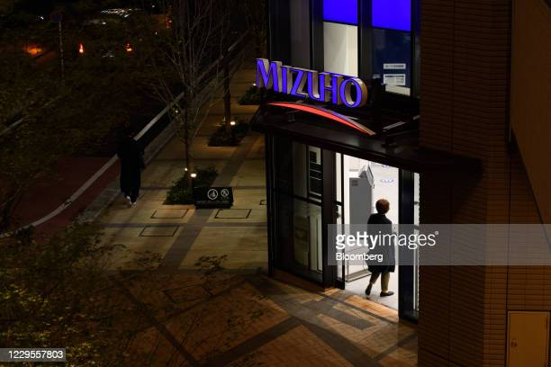 Customer enters a branch of Mizuho Bank Ltd. In Kawasaki, Kanagawa Prefecture, Japan, on Monday, Nov. 9, 2020. Japanese banks expect business...