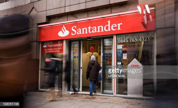 A customer enters a branch of the newlybranded Santander bank on Oxford Street in central London on January 11 2010 Spanish banking giant Santander...