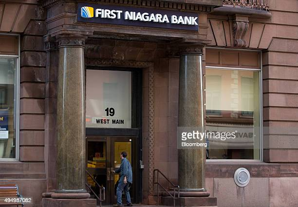 A customer enters a First Niagara Financial Group Inc branch in Rochester New York US on Friday Oct 30 2015 KeyCorp Ohio's secondlargest bank agreed...