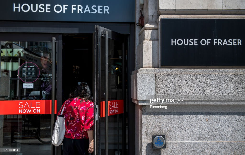 A customer enters a House of Fraser store, one of the stores slated for closure, on King William Street in the City of London, U.K., on Wednesday, June 13, 2018. U.K. department-store chain House of Fraser said it plans to shut more than half its outlets, putting 6,000 jobs at risk. Photographer: Chris J. Ratcliffe/Bloomberg via Getty Images