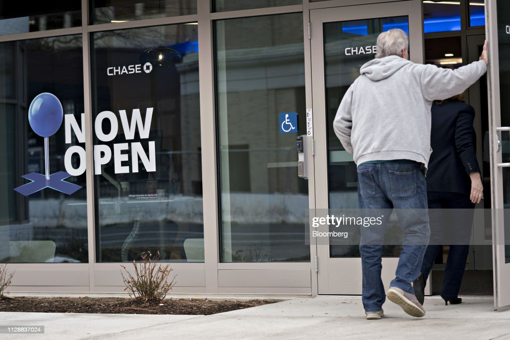 A customer enters a JPMorgan Chase & Co  bank branch in the