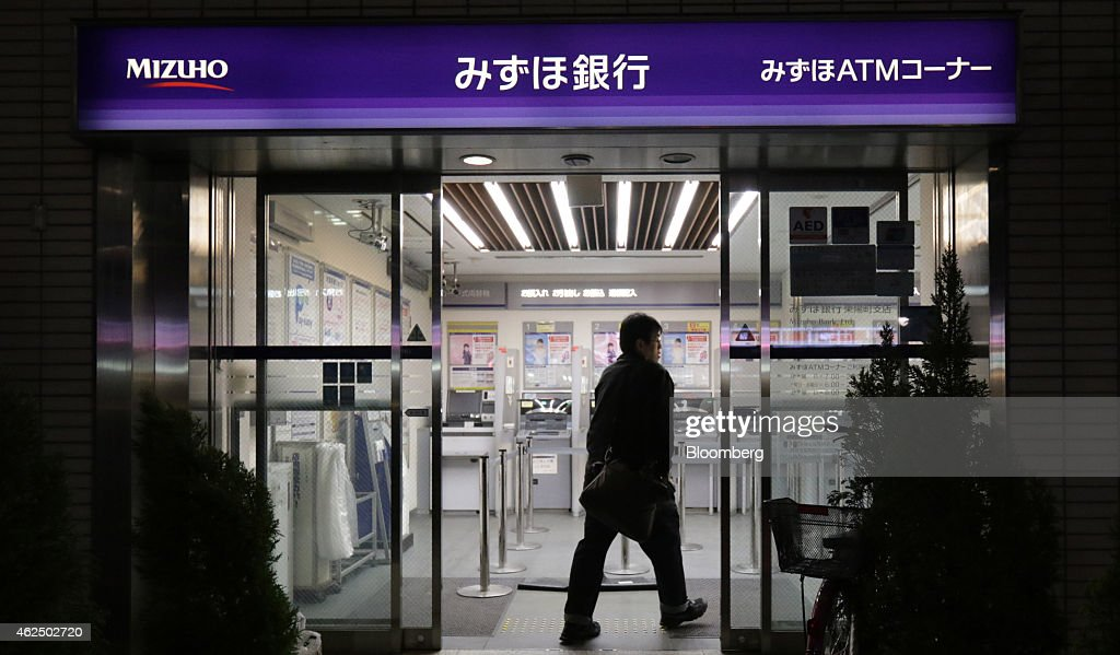 A customer enters a Mizuho Bank Ltd. branch in Tokyo, Japan, on Thursday, Jan. 29, 2015. Mizuho Financial Group Inc., Japan's third largest bank, is scheduled to report third-quarter earnings on Jan. 30. Photographer: Tomohiro Ohsumi/Bloomberg via Getty Images