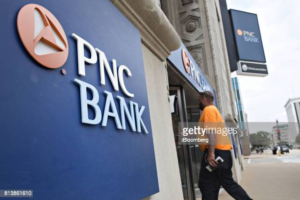 A customer enters a PNC Financial Services Group Inc bank branch in Peoria Illinois US on Monday July 10 2017 PNC Financial Services Group Inc is...