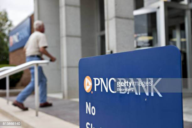 A customer enters a PNC Financial Services Group Inc bank branch in Morton Illinois US on Monday July 10 2017 PNC Financial Services Group Inc is...