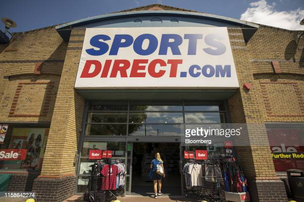A customer enters a Sports Direct International Plc store in Crayford UK on Monday July 29 2019 Sports Direct plunged after the UK retailer reported...