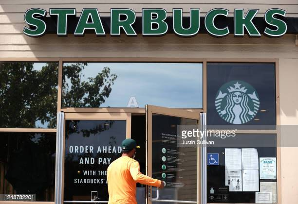 Customer enters a Starbucks Coffee store on June 10, 2020 in San Rafael, California. Starbucks announced plans to close 400 of its company owned...
