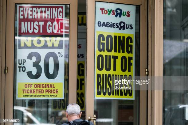 A customer enters a Toys 'R' Us retail store displaying a Going Out Of Business sign at Times Square in New York US on Friday May 11 2018 As playtime...