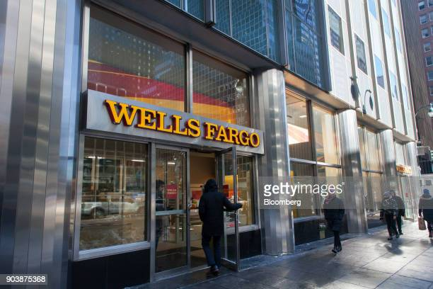 A customer enters a Wells Fargo Co bank branch in New York US on Friday Jan 5 2018 Wells Fargo Co is scheduled to release earnings figures on January...