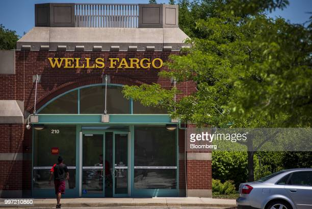 A customer enters a Wells Fargo Co bank branch in Schaumburg Illinois US on Tuesday July 10 2018 Wells Fargo Co is scheduled to release earnings...