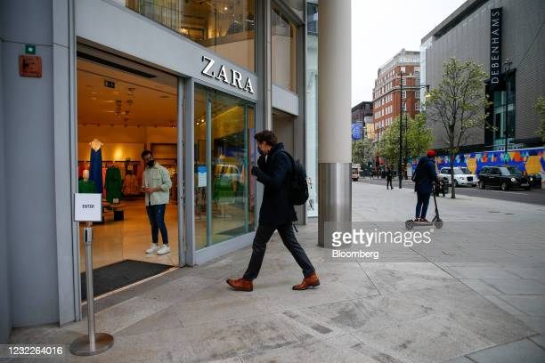Customer enters a Zara clothing store following its reopening in central London, U.K., on Monday, April 12, 2021. Non-essential retailers as well as...