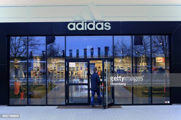 A customer enters an Adidas AG retail store in Herzogenaurach Germany on Wednesday March 8 2017 Adidas' new chief executive officer is doubling down...