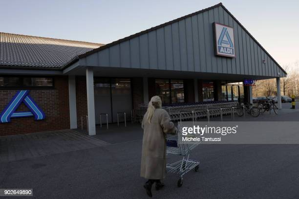A customer enters an ALDI Discount supermarket on January 8 2018 in Berlin Germany According to government statisticians nominal revenue grew...
