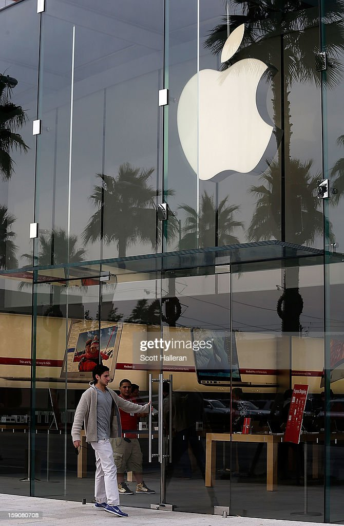 A customer enters an Apple store in the Highland Village shopping center on January 7, 2013 in Houston, Texas. Houston's success with job growth in recent years has placed the city among the top markets in the country for elevated income levels, according to reports.