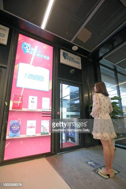 A customer enters an unmanned bookstore using face recognition system on July 17 2018 in Shenzhen Guangdong Province of China Customers can enter the...