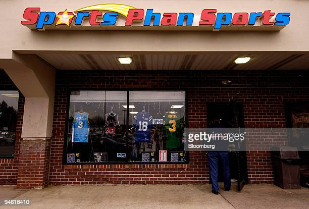 A customer enters Steve Stein's Sports Phan Sports store in Philadelphia Pennsylvania Thursday March 1 2007 In the display window from left to right...