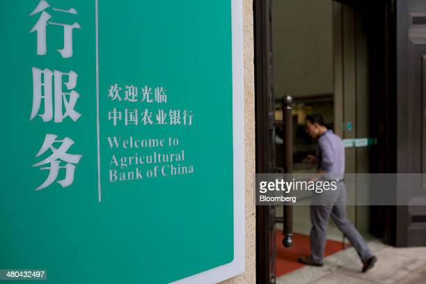 A customer enters the Agricultural Bank of China Ltd Guangdong branch in Guangzhou Guangdong Province China on Tuesday March 25 2014 Agricultural...