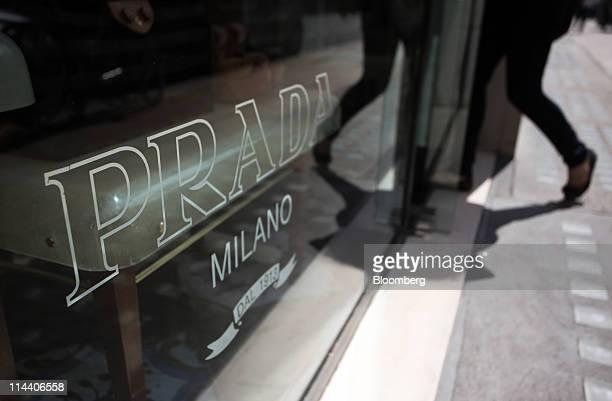Customer enters the Prada boutique on Old Bond Street in London, U.K., on Thursday, May 19, 2011. Prada SpA, the Italian producer of Miu Miu bags and...
