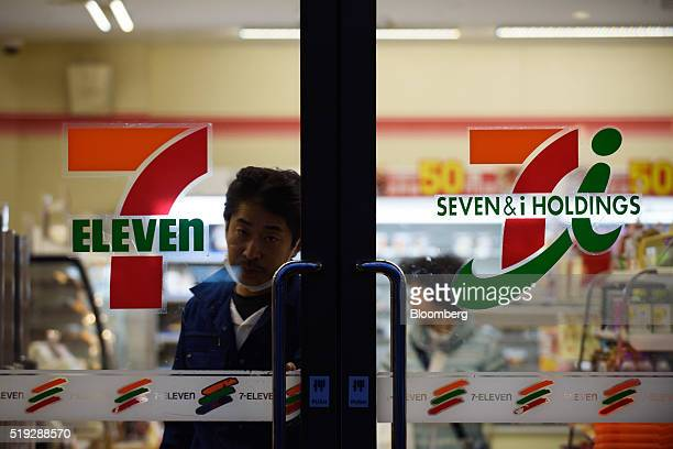 A customer exits a 7Eleven convenience store operated by Seven i Holdings Co in Kawasaki City Kanagawa Prefecture Japan on Tuesday April 5 2016 Seven...