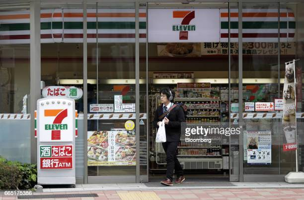 A customer exits a 7eleven convenience store operated by Seven i Holdings Co in Tokyo Japan on Thursday April 6 2017 Seven i the world's largest...