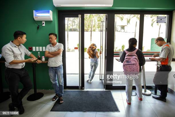 A customer exits a 7Eleven store in Ho Chi Minh City Vietnam on Wednesday June 20 2018 For decades Vietnamese have shopped snacked and hung out at...