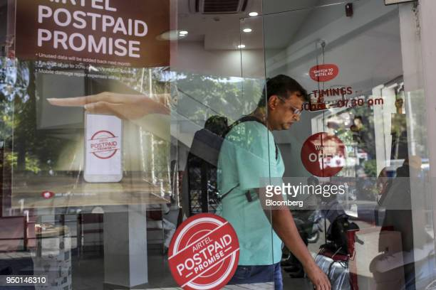 A customer exits a Bharti Airtel Ltd store in Mumbai India on Saturday April 21 2018 Bharti Airtel are scheduled to release earnings on April 24...