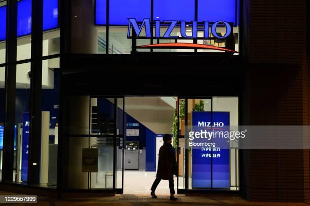 Customer exits a branch of Mizuho Bank Ltd. In Kawasaki, Kanagawa Prefecture, Japan, on Monday, Nov. 9, 2020. Japanese banks expect business...