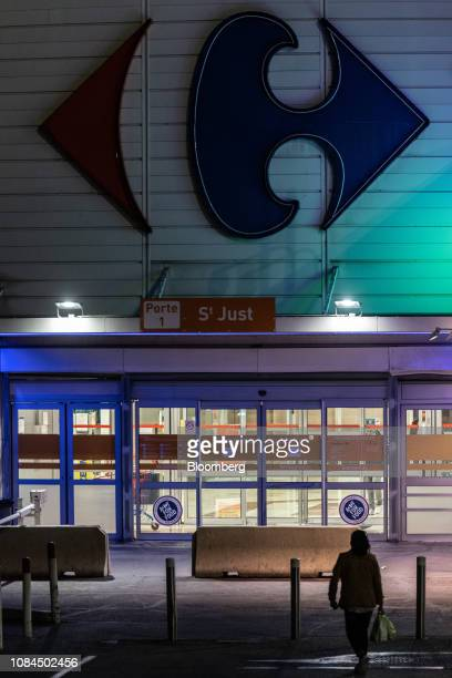 A customer exits a Carrefour SA hypermarket store at night in Marseille France on Thursday Jan 17 2019Shares in French retailers...