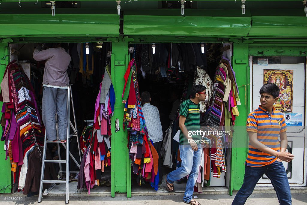 A customer exits a clothing store on Mahatma Gandhi Road in Gangtok, India, on Tuesday, May 3, 2016. Year-on-year growth in Asia's third-largest economy accelerated in the first three months of 2016 to 7.9 percent. Photographer: Prashanth Vishwanathan/Bloomberg via Getty Images