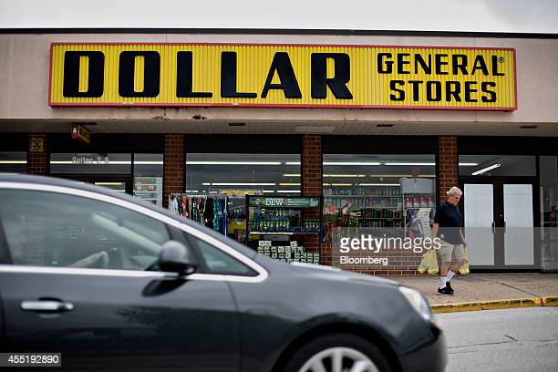 A customer exits a Dollar General Corp store in Silvis Illinois US on Wednesday Sept 10 2014 Dollar General Corp spurned twice in attempts to buy...