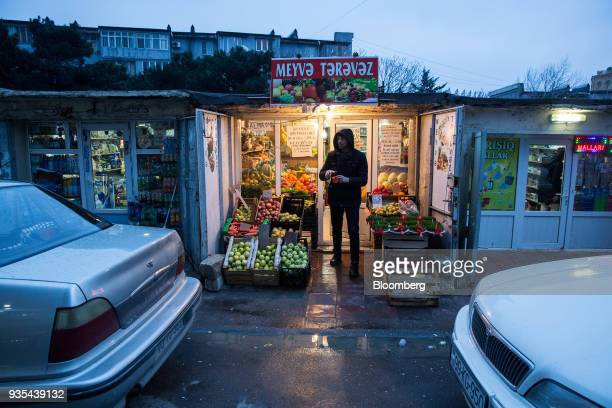 A customer exits a grocery store in Baku Azerbaijan on Saturday March 17 2018 Azerbaijan's economy barely returned to growth last year increasing 01...