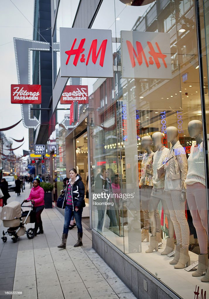 A customer exits a Hennes & Mauritz AB (H&M) store in Stockholm, Sweden, on Tuesday, Jan. 29, 2013. Hennes & Mauritz AB, Europe's second-largest clothing retailer, reported sales growth that beat analysts' estimates for a second consecutive month as the chain offered markdowns in advance of the Christmas holiday. Photographer: Casper Hedberg/Bloomberg via Getty Images