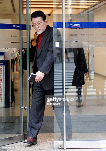 A customer exits a Mizuho Bank Ltd branch in Tokyo Japan on Tuesday Feb 27 2007 Mizuho Financial Group Inc Japan's secondbiggest bank forecast profit...