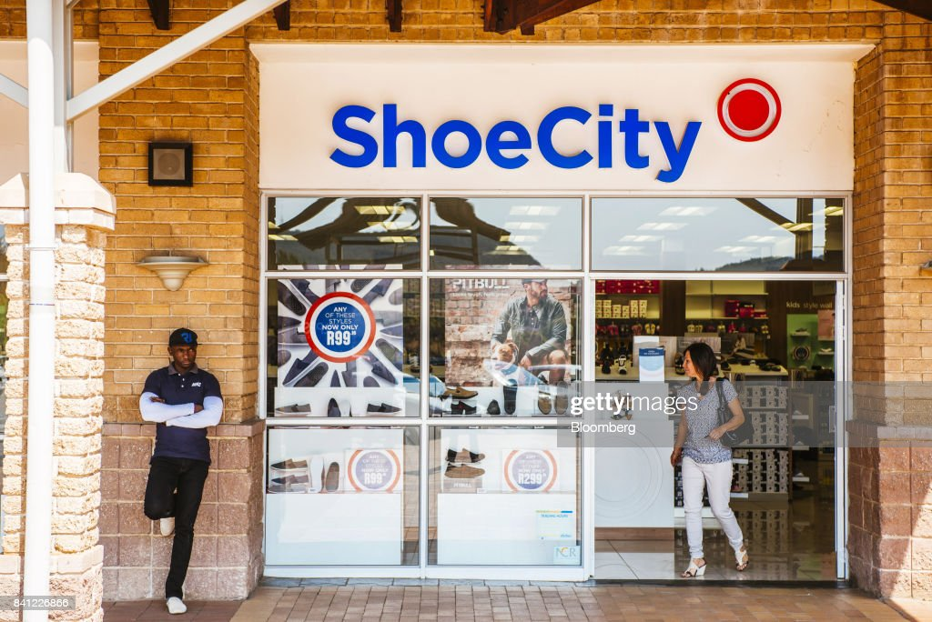 A customer exits a Shoe City shoe store, operated by Steinhoff International Holdings NV, in Pretoria, South Africa, on Thursday, Aug. 31, 2017. Steinhoffsaid like-for-like sales rose 8 percent as the South African furniture and clothing retailer achieved gains in its core European and African markets. Photographer: Waldo Swiegers/Bloomberg via Getty Images