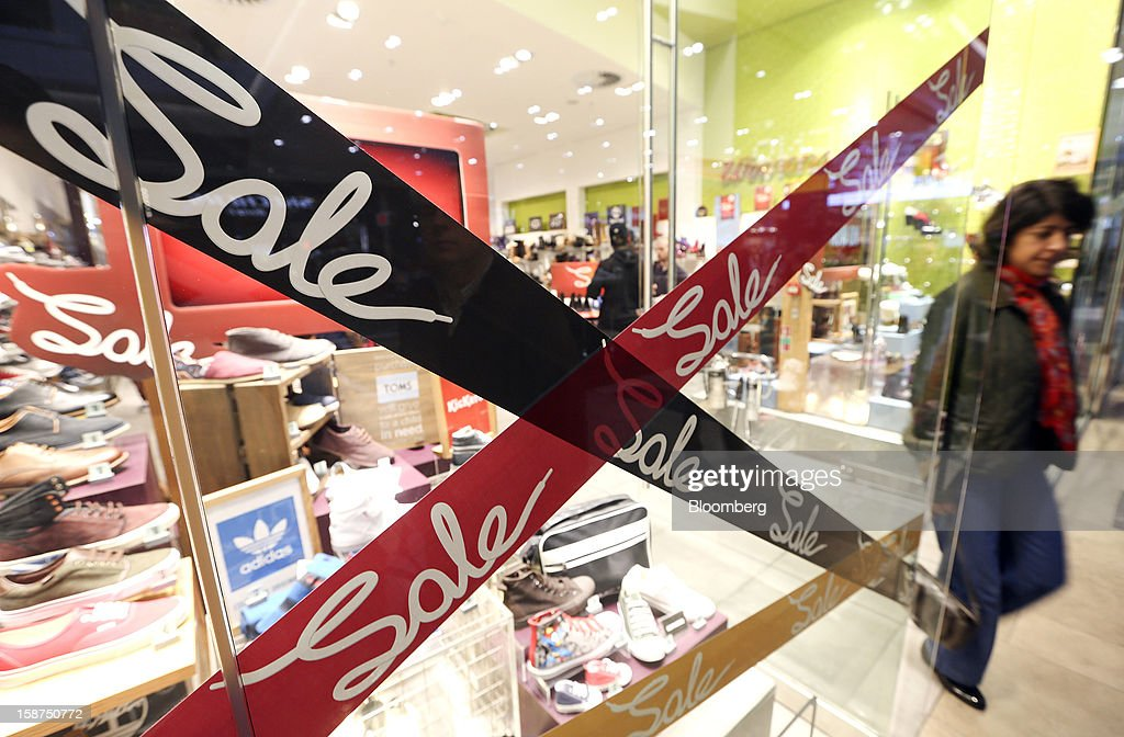 A customer exits a store advertising a sale in its window display at the Westfield Stratford City shopping mall in London, U.K., on Thursday, Dec. 27, 2012. Overall Christmas shopping in the U.K. was similar to last year, according to the British Retail Consortium. Photographer: Chris Ratcliffe/Bloomberg via Getty Images