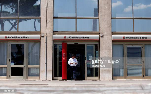 Customer exits a UniCredit SpA bank branch in Rome, Italy, on Tuesday, July 17, 2012. UniCredit SpA and Intesa Sanpaolo SpA were among 13 Italian...