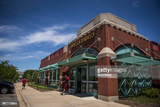 A customer exits a Wells Fargo Co bank branch in Schaumburg Illinois US on Tuesday July 10 2018 Wells Fargo Co is scheduled to release earnings...